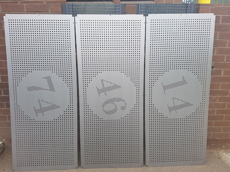 Perforated sheets of metal in grey steel with numbers